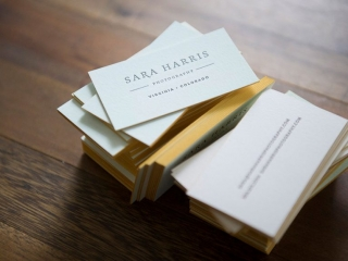 Blue water color business cards, gold edge painting. Brown ink letterpress on both sides set on a wood background.