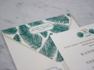Letterpress Invitation Rehearsal Dinner, printed on Crane cotton Lettra paper. Gold metallic ink with green. Set on a marble background