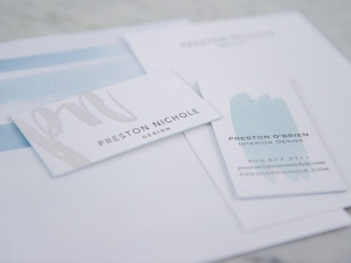 watercolor blue with grey letterpress business cards, stationery and envelope. Envelopes are lined with a digitally printed linter that features watercolor brushstrokes. Set on a marble slab